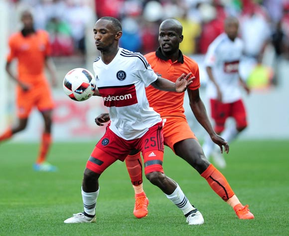 Thabo Rakhale of Orlando Pirates challenged by Simphiwe Hlongwane of Polokwane City during the Absa Premiership match between Polokwane City and Orlando Pirates at the Peter Mokaba Stadium in Polokwane on 16 October 2016©Samuel Shivambu/Backpagepix