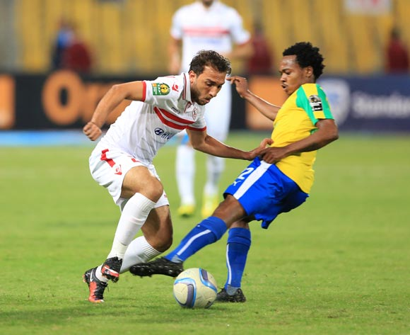 Ramzi Khaled of Zamalek tackled by Percy Tau of Mamelodi Sundowns during the 2016 CAF Champions League Final second leg between Zamalek and Sundowns at the Borg El Arab Stadium in Alexandria, Egypt on 23 October 2016 ©Gavin Barker/BackpagePix