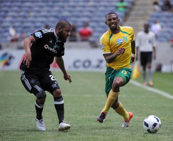 Riyaad Norodien of Orlando Pirates challenges Wayde Jooste of Golden Arrows during the Telkom Knockout Last 16 match between Orlando Pirates and Golden Arrows  on the  23 October 2016 at Orlando Stadium Pic Sydney Mahlangu/ BackpagePix