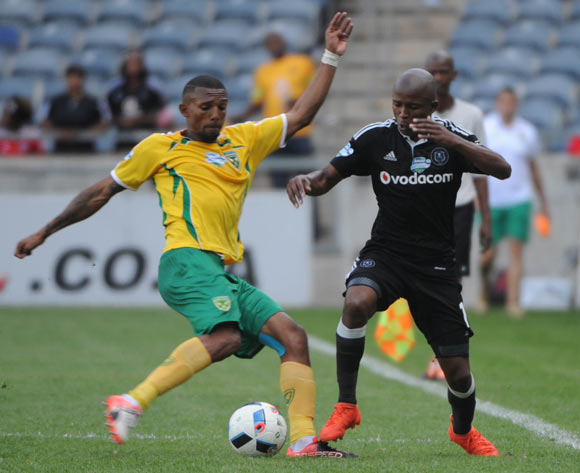 Luvuyo Memela of Orlando Pirates is challenged by Wayde Jooste of Golden Arrows  during the Telkom Knockout Last 16 match between Orlando Pirates and Golden Arrows  on the  23 October 2016 at Orlando Stadium Pic Sydney Mahlangu/ BackpagePix