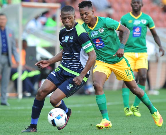 Ndumiso Mabena of Platinum Stars challenged by Richard Matloga of Baroka FC during the Telkom Knockout Last 16 match between Baroka FC and Platinum Stars at the Peter Mokaba Stadium in Polokwane on the 23 October 2016©Samuel Shivambu/Backpagepix