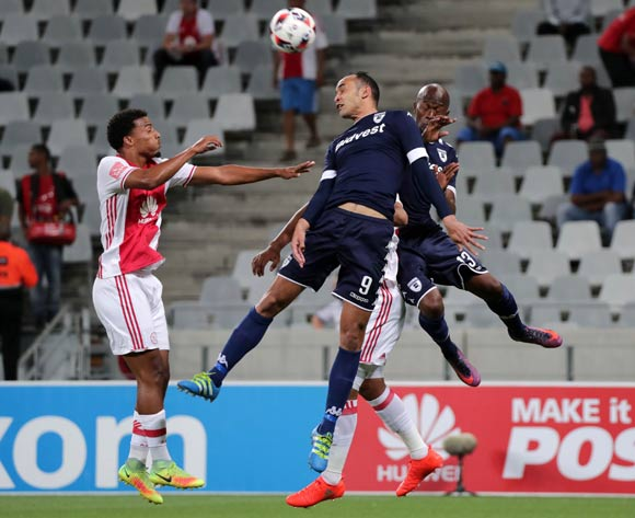 Eleazar Rodgers of Bidvest Wits and Sifiso Hlanti of Bidvest Wits battles for the ball with Rivaldo Coetzee of Ajax Cape Town and Erick Chipeta of Ajax Cape Town during the Absa Premiership 2016/17 football match between Ajax Cape Town and Bidvest Wits at Cape Town Stadium, Cape Town on 26 October 2016 ©Chris Ricco/BackpagePix