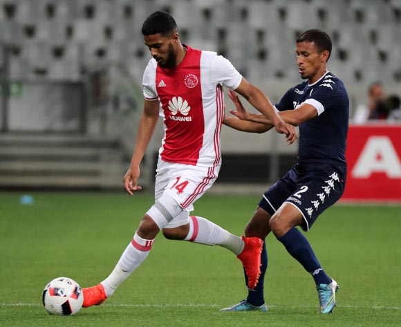 Tashreeq Morris of Ajax Cape Town evades challenge from Nazeer Allie of Bidvest Wits during the Absa Premiership 2016/17 football match between Ajax Cape Town and Bidvest Wits at Cape Town Stadium, Cape Town on 26 October 2016 ©Chris Ricco/BackpagePix