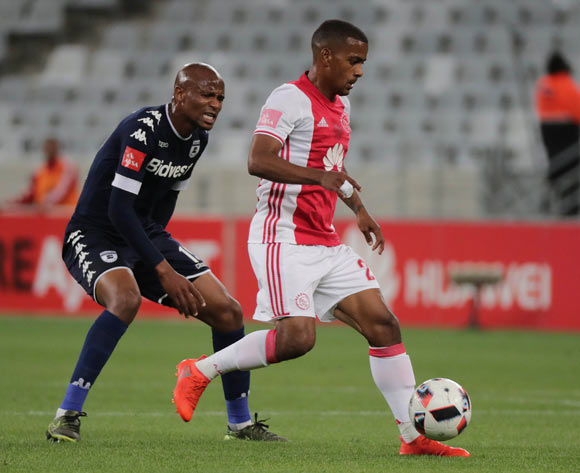 Xola Mlambo of Bidvest Wits challeges Erwin Isaacs of Ajax Cape Town during the Absa Premiership 2016/17 football match between Ajax Cape Town and Bidvest Wits at Cape Town Stadium, Cape Town on 26 October 2016 ©Chris Ricco/BackpagePix