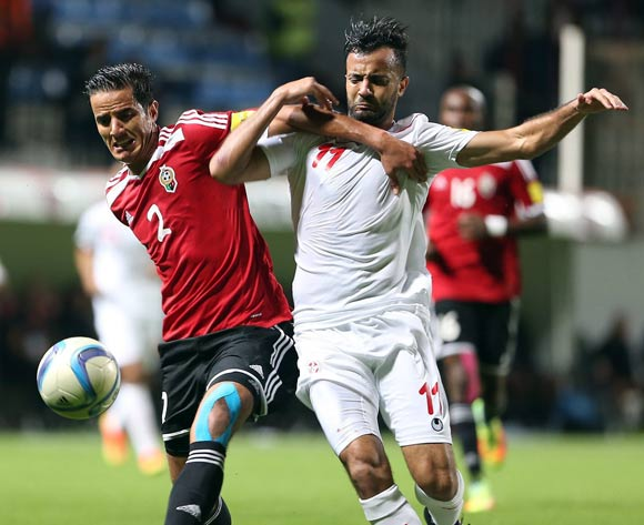 epa05627645 Tunisia's player Kheniss Taha Yassine  (R) in action against Libyan Tariq Nasr Aljamal (L) during the FIFA World Cup 2018 qualifying soccer match between Libya and Tunisia at Omar-Hamadi Stadium in Algiers, Algeria, 11 November 2016.  EPA/-