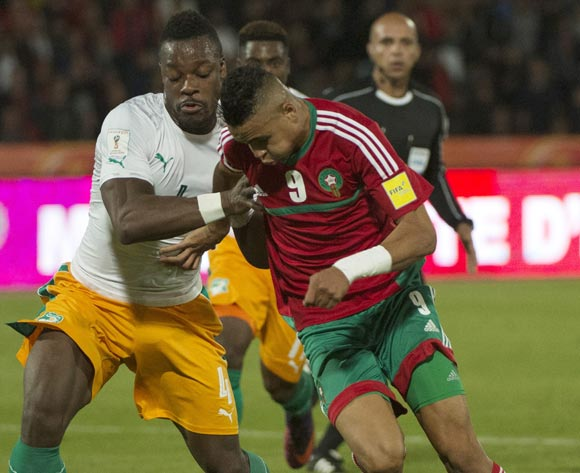 epa05629203 Morocco's Youssef En Nesyri (R) in action against Ivory Coast's Lamine Kone (L) during the 2018 FIFA World Cup Russia qualifier soccer game between Morocco and the Ivory Coast at the Marrakesh Stadium in Marrakech, Morocco, 12 November 2016.  EPA/STR