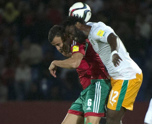 epa05629205 Morocco's Romain Ghannam Saiss (L) in action against Ivory Coast's Wilfried Bony (R) during the 2018 FIFA World Cup Russia qualifier soccer game between Morocco and the Ivory Coast at the Marrakesh Stadium in Marrakech, Morocco, 12 November 2016.  EPA/STR