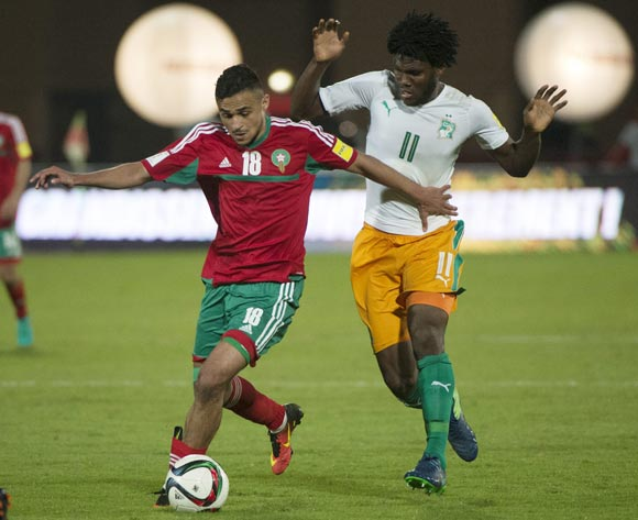 epa05629207 Morocco's Sofiane Boufal (L) in action against Ivory Coast's Franck Kessie (R) during the 2018 FIFA World Cup Russia qualifier soccer game between Morocco and the Ivory Coast at the Marrakesh Stadium in Marrakech, Morocco, 12 November 2016.  EPA/STR