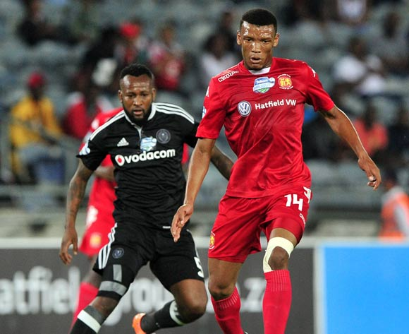 Mothobi Mvala of Highlands Park gets his pass away as Mpho Makola of Orlando Pirates moves in during the 2016 Telkom Knockout quarterfinal game between Orlando Pirates and Highlands Park at Orlando Stadium, Johannesburg on 5 November 2016 © Ryan Wilkisky/BackpagePix