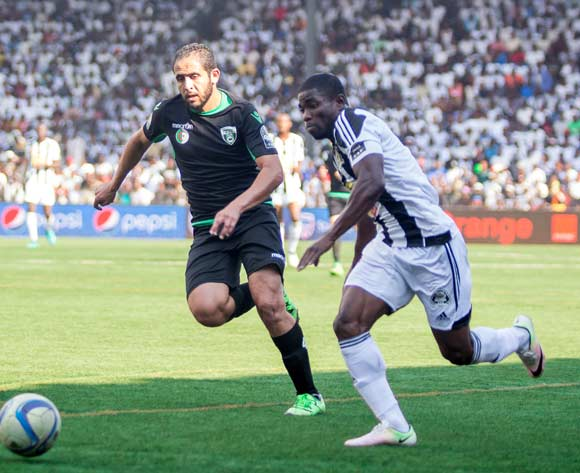 Roger Claver Assale of TP Mazembe beats Bejaia defender to the ball
