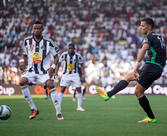 Sfiane Khadir of Bejaia of Algeria passes the ball during the game against TP Mazembe in Congo