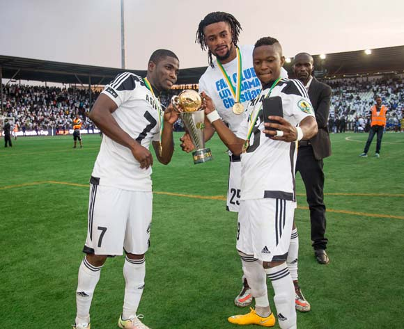 TP Mazembe midfielder Rainford Kalaba takes a selfie with the trophy