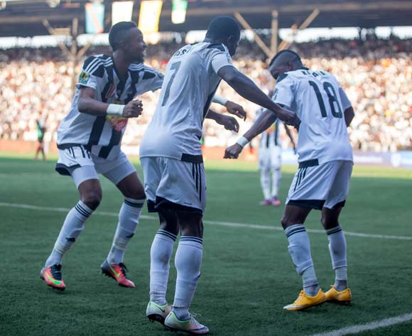 TP Mazembe players celebrate after scoring the fourth goal in the Final of the Confederation Cup
