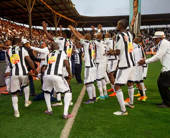 TP Mazembe players celebrate after wining the Confederation of Africa Cup final against Mouloudia Olympique Bejaia of Algeria