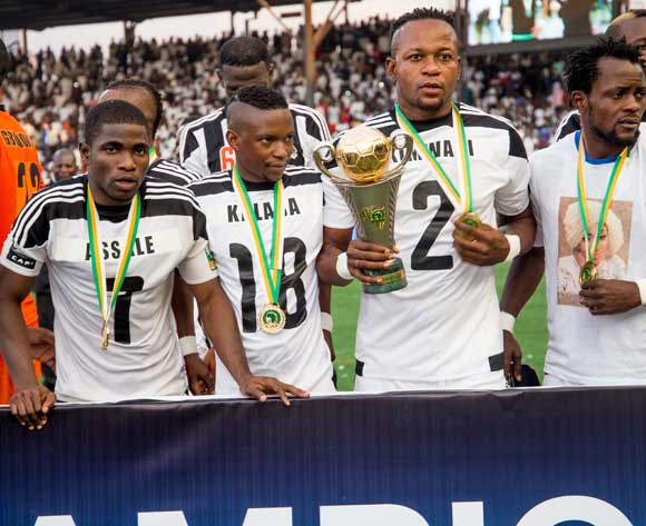 TP Mazembe players pose for a photo with the Trophy