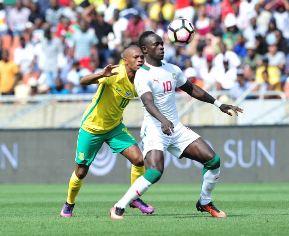 Sadio Mane of Senegal challenged by Thulani Serero of South Africa during 2018 World Cup Qualifiers match between South Africa and Senegal at Peter Mokab Stadium, November on the 12 November 2016 © Samuel Shivambu/BackpagePix