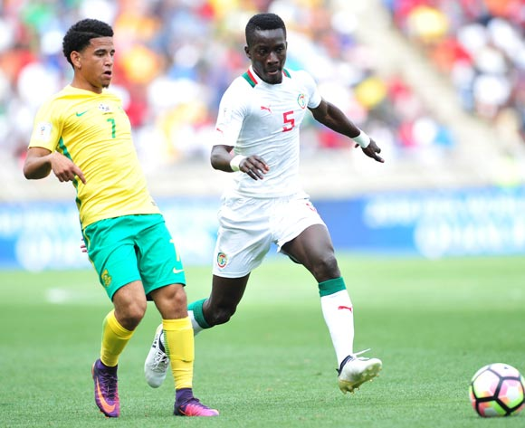Keagan Dolly of South Africa challenged by Idrissa Gana Gueye of Senegal during 2018 World Cup Qualifiers match between South Africa and Senegal at Peter Mokab Stadium, November on the 12 November 2016 © Samuel Shivambu/BackpagePix
