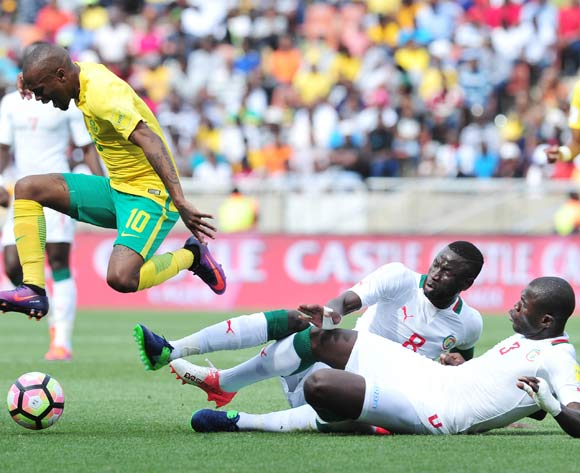 Thulani Serero (r) of South Africa challenged by Cheikou Kouyate (c) and  Kalodou Koulibaly (l) of Senegal during 2018 World Cup Qualifiers match between South Africa and Senegal at Peter Mokab Stadium, November on the 12 November 2016 © Samuel Shivambu/BackpagePix