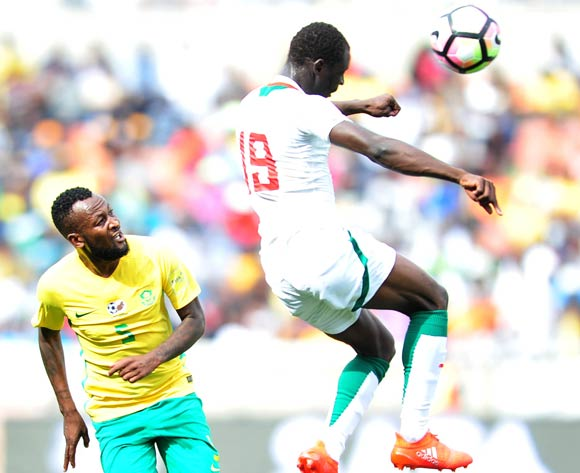 Saliou Ciss of Senegal challenged by Mpho Makola of South Africa during 2018 World Cup Qualifiers match between South Africa and Senegal at Peter Mokab Stadium, November on the 12 November 2016 © Samuel Shivambu/BackpagePix