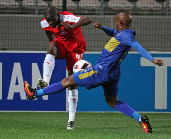 Kwanda Mngonyama of Maritzburg United clears ball from Aubrey Ngoma of Cape Town City FC during the Absa Premiership 2016/17 football match between Cape Town City FC and Maritzburg United at Athlone Stadium, Cape Town on 22 November 2016 ©Chris Ricco/BackpagePix