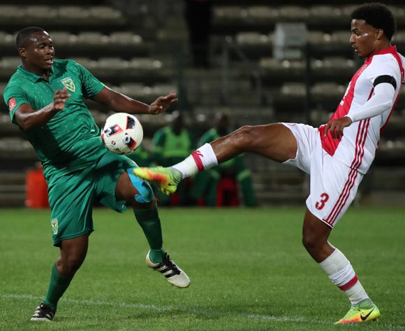 Kagisho Dikgacoi of Golden Arrows and Rivaldo Coetzee of Ajax Cape Town challenge for ball during the Absa Premiership 2016/17 football match between Ajax Cape Town and Golden Arrows at Athlone Stadium, Cape Town on 3 December 2016 ©Chris Ricco/BackpagePix