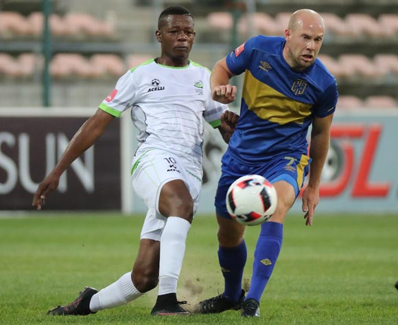 Matt Sim of Cape Town City FC tackled by Ndumiso Mabena of Platinum Stars during the Absa Premiership 2016/17 football match between Cape Town City FC and Platinum Stars at Athlone Stadium, Cape Town on 13 December 2016 ©Chris Ricco/BackpagePix