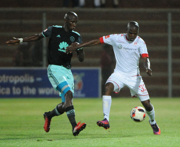 Junior Sibande of Highlands Park is challenged by Mark Mayambela of Ajax Cape Town  during the Absa Premiership match between Highlands Park and Ajax Cape Town on the 14 December 2016 at Makhulong Stadium Pic Sydney Mahlangu/ BackpagePix