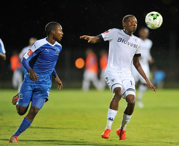 Mogakolodi Ngele of Bidvest Wits challenged by Bandile Shandu of Maritzburg United during the Absa Premiership 2016/17 match between Maritzburg United and Bidvest Wits at Harry Gwala Stadium, Pietermaritzburg South Africa on 20 December 2016 ©Muzi Ntombela/BackpagePix