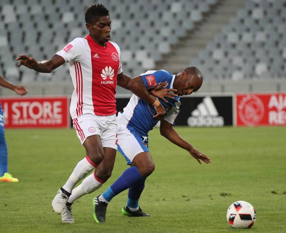 Katlego Mashego of Chippa United challenged by Lawrence Lartey of Ajax Cape Town during the Absa Premiership 2016/17 football match between Ajax Cape Town and Chippa United at Cape Town Stadium, Cape Town on 21 December 2016 ©Chris Ricco/BackpagePix