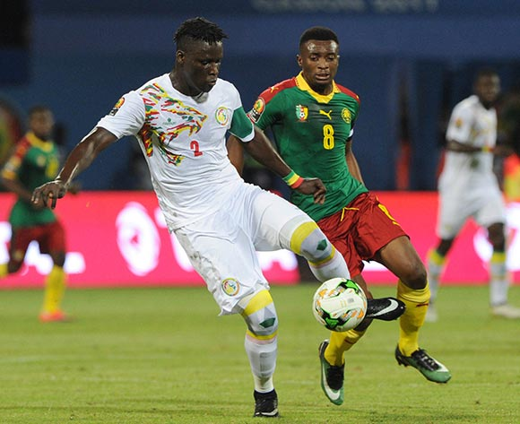 Serigne Mbodji of Senegal is challenged by Benjamin Moukandjo of Cameroon during the Afcon Quarter Final match between Senegal and Cameroon on the 28 January 2017 at Franceville , Gabon Pic Sydney Mahlangu/ BackpagePix