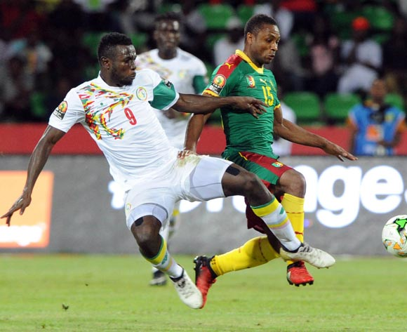 Mame Biram Diof of Senegal tackles Sebastien Siani of Cameroon  during the Afcon Quarter Final match between Senegal and Cameroon on the 28 January 2017 at Franceville , Gabon Pic Sydney Mahlangu/ BackpagePix
