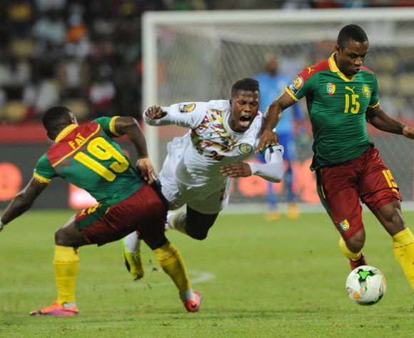 Keita Balde of Senegal is challenged by Collins Fai of Cameroon  during the Afcon Quarter Final match between Senegal and Cameroon on the 28 January 2017 at Franceville , Gabon Pic Sydney Mahlangu/ BackpagePix