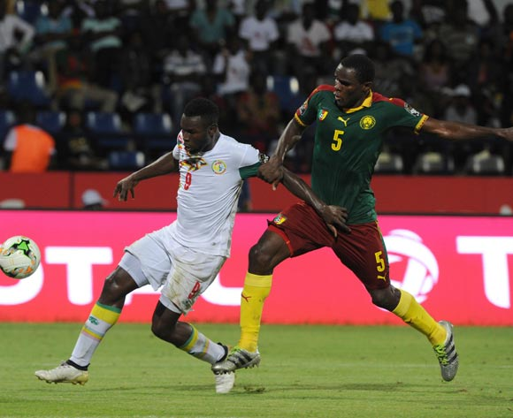 Mame Biram Diof of Senegal is challenged by Michael Ngadeu of Cameroon  during the Afcon Quarter Final match between Senegal and Cameroon on the 28 January 2017 at Franceville , Gabon Pic Sydney Mahlangu/ BackpagePix
