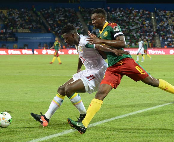 Lamine Gassama of Senegal challenges Benjamin Moukandjo of Cameroon  during the Afcon Quarter Final match between Senegal and Cameroon on the 28 January 2017 at Franceville , Gabon Pic Sydney Mahlangu/ BackpagePix