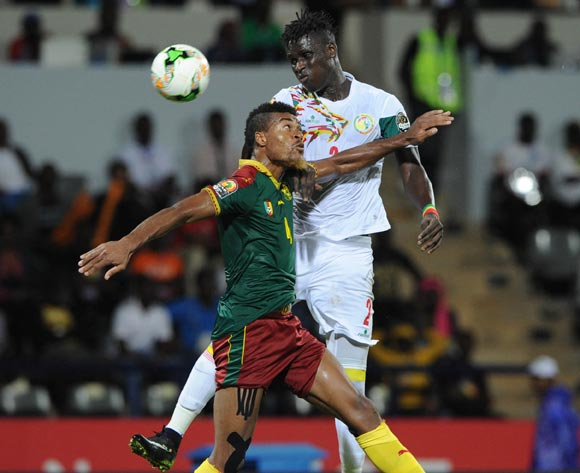 Serigne Mbodji of Senegal is challenged by Adolph Teikeu Kamgang of Cameroon   during the Afcon Quarter Final match between Senegal and Cameroon on the 28 January 2017 at Franceville , Gabon Pic Sydney Mahlangu/ BackpagePix