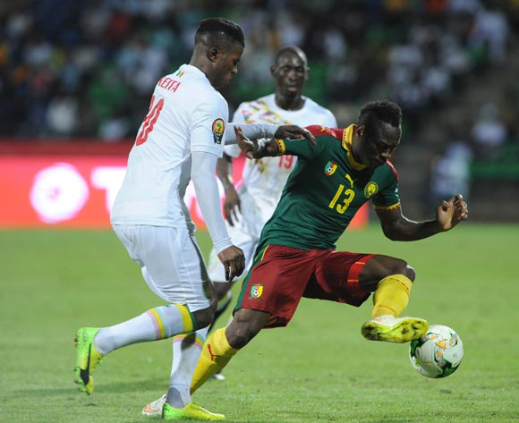 Christian Bassogog of Cameroon is challenged by Keita Balde of Senegal  during the Afcon Quarter Final match between Senegal and Cameroon on the 28 January 2017 at Franceville , Gabon Pic Sydney Mahlangu/ BackpagePix
