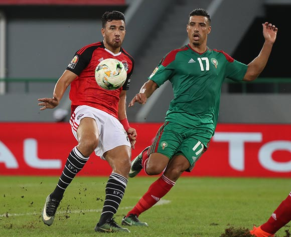 Mahmoud Hassan Trezeguet of Egypt evades tackle from Nabil Dirar of Morocco during the 2017 Africa Cup of Nations Finals football Quarter Final match between Egypt and Morocco at the Port Gentil Stadium in Gabon on 29 January 2017 ©Chris Ricco/BackpagePix