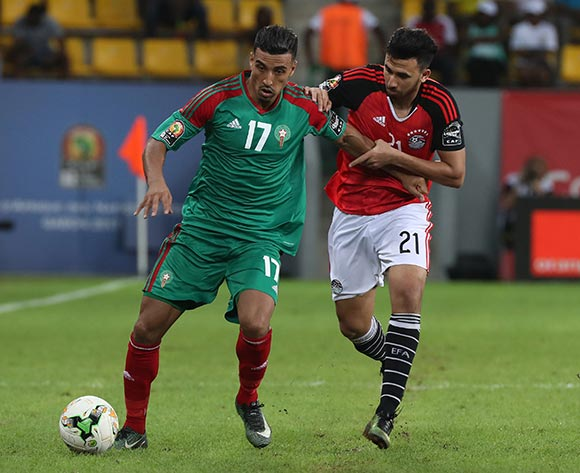 Nabil Dirar of Morocco evades tackle from Mahmoud Hassan Trezeguet of Egypt during the 2017 Africa Cup of Nations Finals