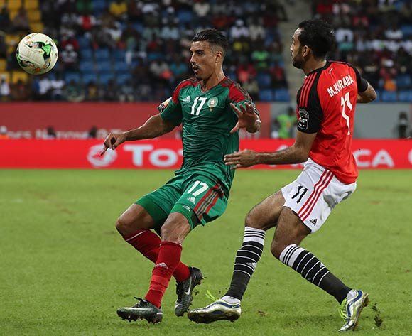 Nabil Dirar of Morocco evades tackle from Mahmoud Abdelmoneim Kahraba of Egypt  during the 2017 Africa Cup of Nations Finals football Quarter Final match between Egypt and Morocco at the Port Gentil Stadium in Gabon on 29 January 2017 ©Chris Ricco/BackpagePix