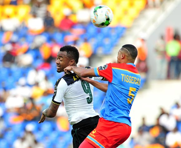 Jordan Ayew of Ghana challenged by Marcel Tisserand of DR Congo during the 2017 Africa Cup of Nations Finals Afcon Quarter Final football match between  DR Congo and Ghana at the Oyem Stadium in Gabon on 29 January 2017 ©Samuel Shivambu/BackpagePix