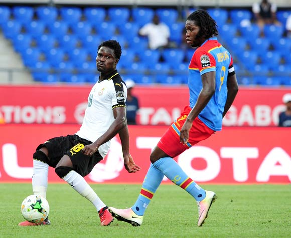 Daniel Amartey of Ghana challenged by Dieudonne Bezua Mbokani of DR Congo during the 2017 Africa Cup of Nations Finals Afcon Quarter Final football match between  DR Congo and Ghana at the Oyem Stadium in Gabon on 29 January 2017 ©Samuel Shivambu/BackpagePix