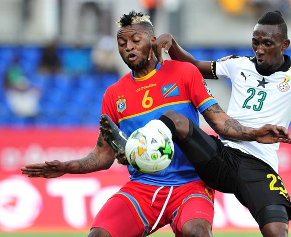AFCON 2017 top scorer Junior Kabananga of DR Congo (left) challenged by Harrison Afful of Ghana