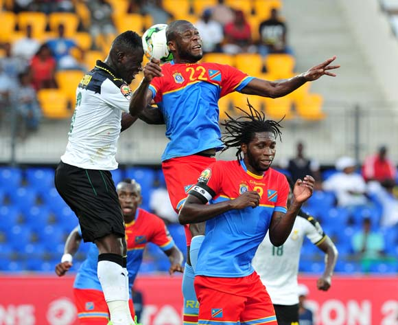 Chancel Mbemba (c) of DR Congo challenged by Afriyie Acquah (l) of Ghana during the 2017 Africa Cup of Nations Finals Afcon Quarter Final football match between  DR Congo and Ghana at the Oyem Stadium in Gabon on 29 January 2017 ©Samuel Shivambu/BackpagePix