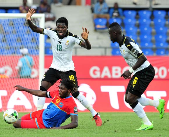 Dieudonne Bezua Mbokani of DR Congo challenged by Daniel Amartey of Ghana during the 2017 Africa Cup of Nations Finals Afcon Quarter Final football match between  DR Congo and Ghana at the Oyem Stadium in Gabon on 29 January 2017 ©Samuel Shivambu/BackpagePix