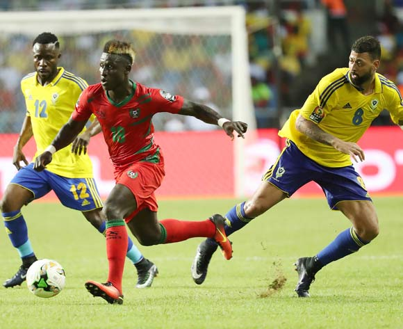 Piqueti Djassi Brito of Guinea Bissau (c) gets through defence of Lloyd Palun (r) and Guelor Kanga Kaku of Gabon during the 2017 Africa Cup of Nations Finals football match between Gabon and Guinea Bissau at the Libreville Stadium in Gabon on 14 January 2017 ©Gavin Barker/BackpagePix