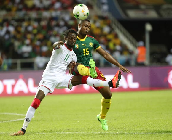 Sébastien Siani of Cameroon  (r) clears from Jonathan Pitroipa of Burkina Faso during the 2017 Africa Cup of Nations Finals football match between Burkina Faso and Cameroon at the Libreville Stadium in Gabon on 14 January 2017 ©Gavin Barker/BackpagePix