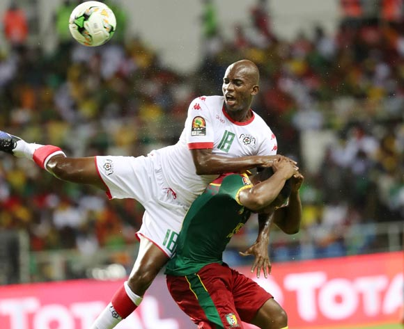 Charles Kabore of Burkina Faso clears from Sébastien Siani of Cameroon  during the 2017 Africa Cup of Nations Finals football match between Burkina Faso and Cameroon at the Libreville Stadium in Gabon on 14 January 2017 ©Gavin Barker/BackpagePix