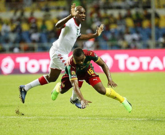 Sébastien Siani of Cameroon fouled by Charles Kabore of Burkina Faso during the 2017 Africa Cup of Nations Finals football match between Burkina Faso and Cameroon at the Libreville Stadium in Gabon on 14 January 2017 ©Gavin Barker/BackpagePix