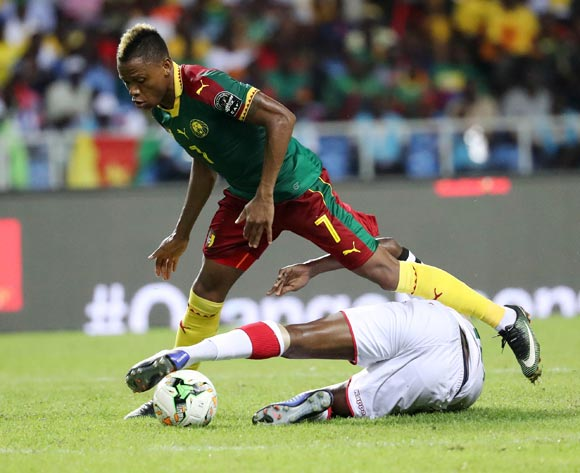 Clinton Njie of Cameroon evades tackle from Charles Kabore of Burkina Faso  during the 2017 Africa Cup of Nations Finals football match between Burkina Faso and Cameroon at the Libreville Stadium in Gabon on 14 January 2017 ©Gavin Barker/BackpagePix