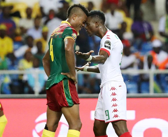 Adolph Teikeu of Cameroon (l) and Banou Diawara of Burkina Faso (r) confront each other during the 2017 Africa Cup of Nations Finals football match between Burkina Faso and Cameroon at the Libreville Stadium in Gabon on 14 January 2017 ©Gavin Barker/BackpagePix